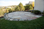 flagstone patio and boulder wall - colorado springs landscaping